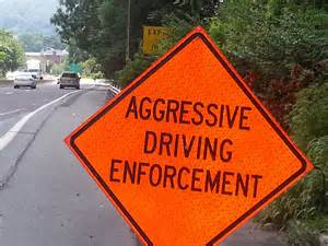 agressive driving Aggressive driving can refer to any display of aggression by a driver, tailgating, flashing headlights, speeding or weaving through traffic are just some forms of aggressive driving extreme acts of physical assault that result from disagreements between drivers are a form of aggression commonly called road rage.